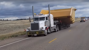 Wide load truck on the road, over-dimensional load, wide load hauler